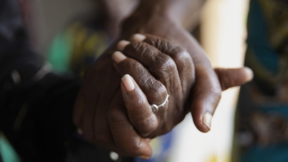 Two members of the 'Standing Women' association hold hands during Mother's Day celebrations in Bangui, Central African Republic.