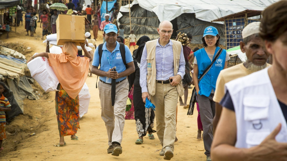 UNHCR's Assistant High Commissioner for Protection Volker Türk (centre) is accompanied by staff as he walks around the Kutupalong extension site in south-east Bangladesh.