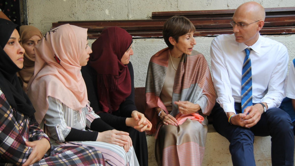 UNHCR Assistant High Commissioner for Protection, Volker Türk and UNHCR representative to Lebanon Mireille Girard meet a group of Syrian refugee women.