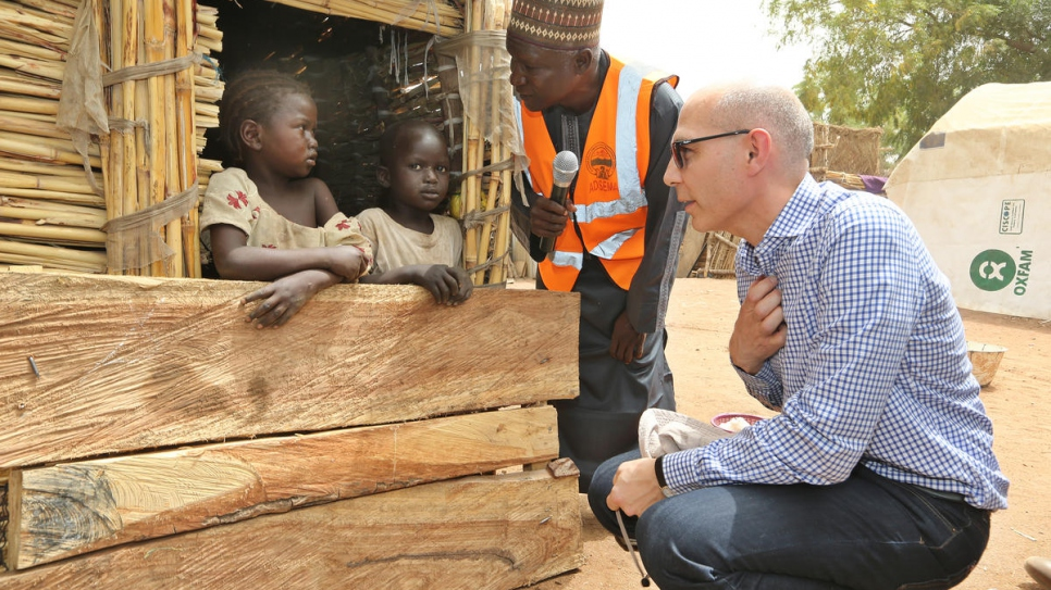 UNHCR Assistant High Commissioner for Protection Volker Türk chats with two young Nigerians, among an estimated 2.2 internally displaced civilians driven from their homes by Boko Haram.