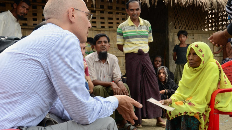 Assistant High Commissioner for Protection Volker Türk speaks with an elderly woman in a Rohingya village near Maungdaw, northern Rakhine State.