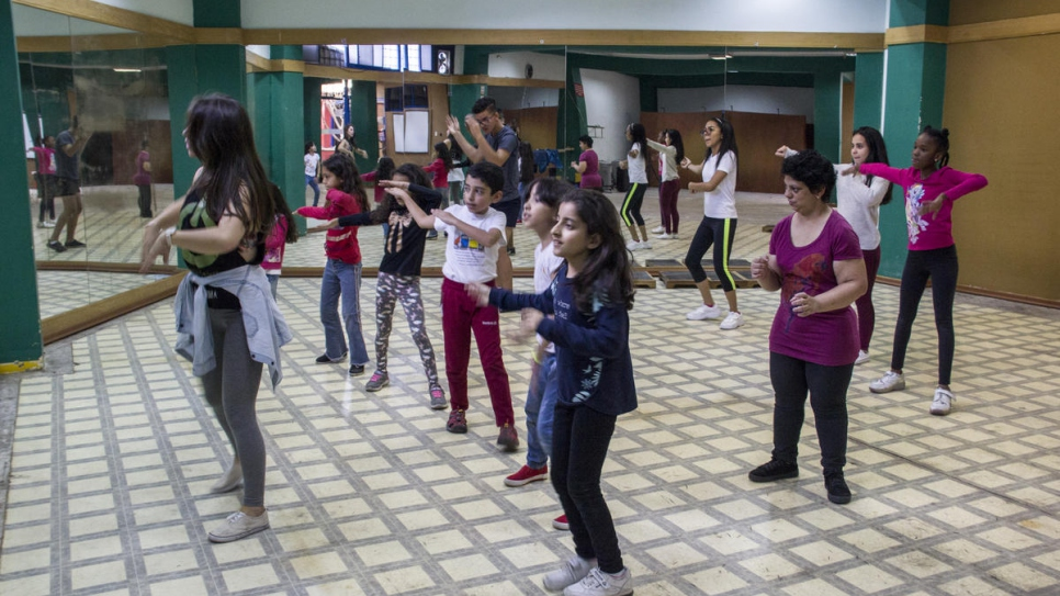 Adrianna - third from right, in purple - takes a dance class in Ecuador where she is among Venezuelans seeking safety.