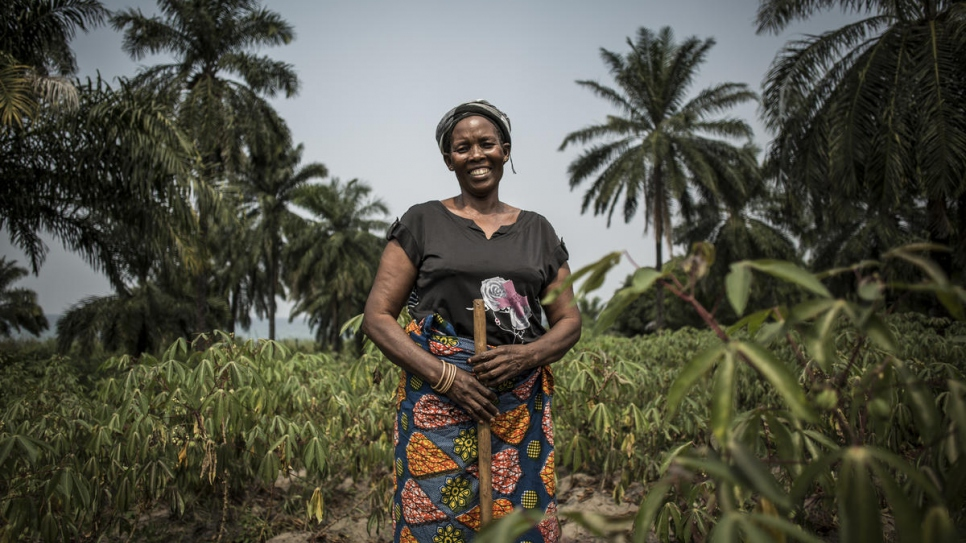Ungwa Sangani, a 50-year-old internally displaced widow and mother of six, is photographed on farmland that is part of Evariste Mfaume's agricultural project in Lusenda.