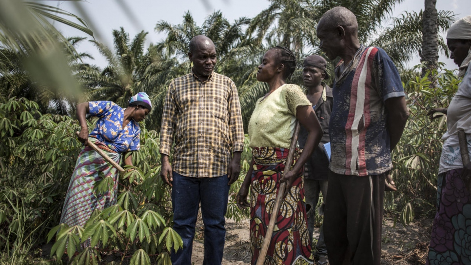 Congolese human rights activist, Evariste Mfaume, talks to beneficiaries of his agricultural project at Lusenda refugee camp.