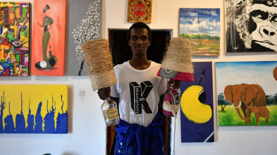 Djamal displays some of his creations amid a display of artwork at the centre.