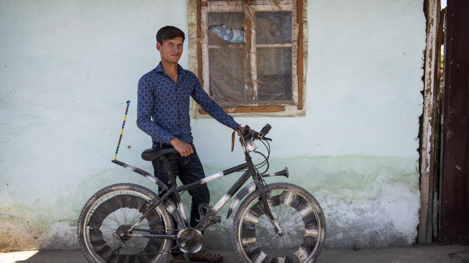 Nazir with the customized bicycle he uses to ride around the local area.