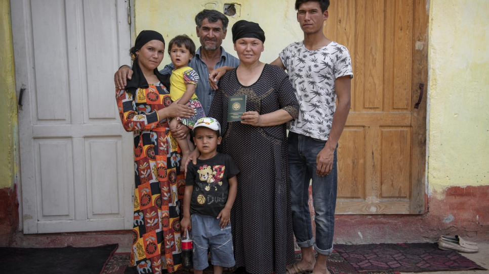 Nazir (right) with his family at the home they share on the outskirts of Osh, Kyrgyzstan.