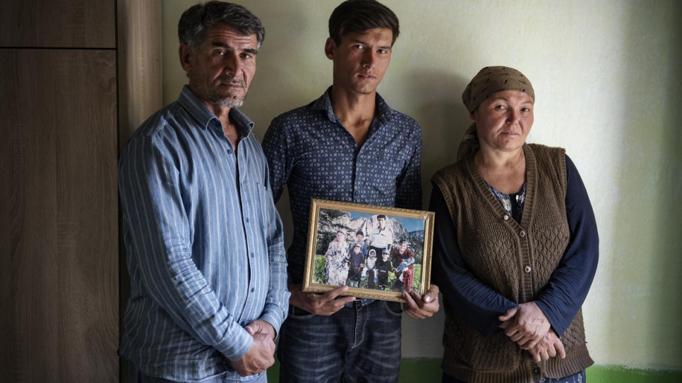Nazir, 21, at home with his father Nasyr, 48, and mother Sanabar, 46.