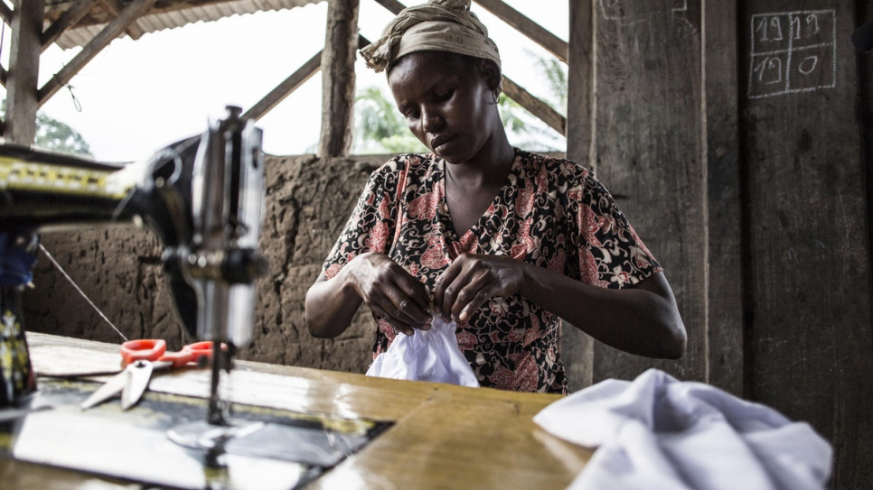 Clementine, a survivor of the Lord's Resistance Army, teaches a tailoring class at Sister Angelique's centre in Dungu, Democratic Republic of Congo.