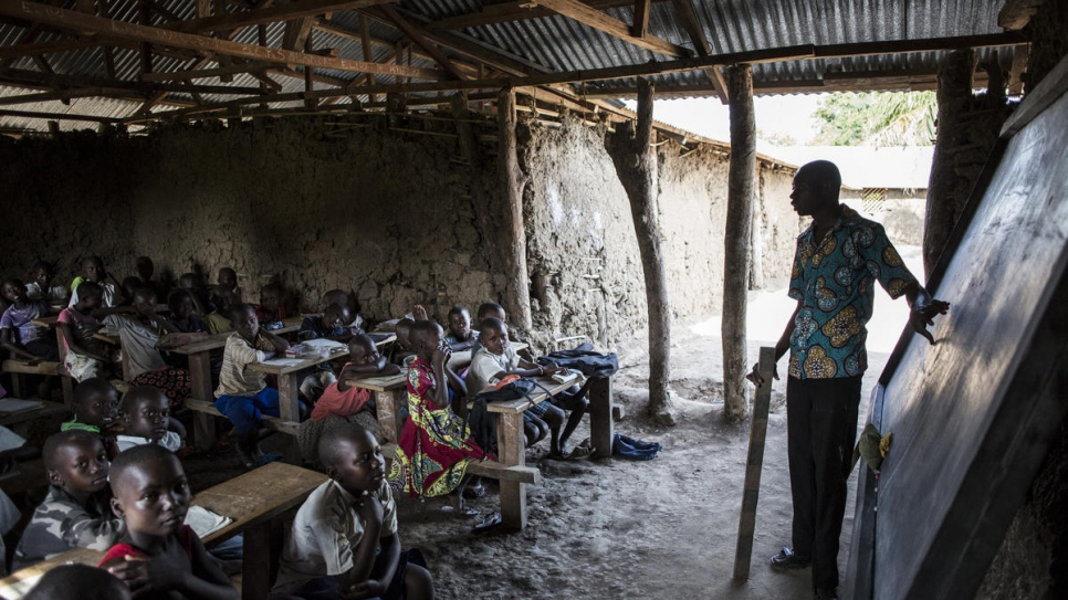 A teacher teaches a class at a school co-run by 2013 Nansen Refugee Award winner, Sister Angelique Namaika in Dungu, Democratic Republic of Congo.
