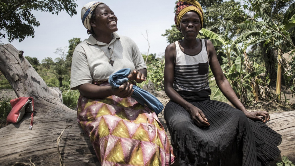 Nansen Refugee Award laureate, Sister Angelique Namaika (left), talks with a woman who works in her agricultural fields in Dungu, Democratic Republic of Congo.