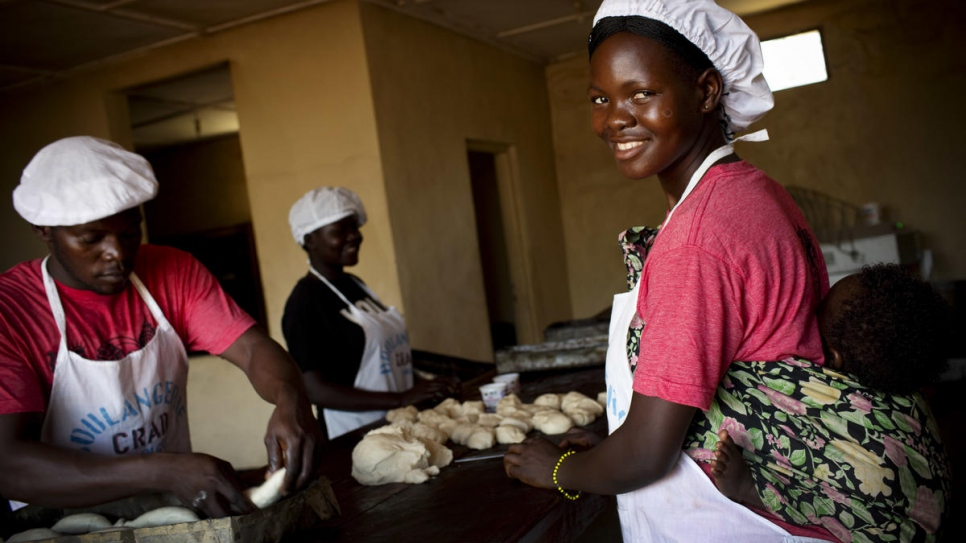 Marie (right) was kidnapped for eight months by the Lord's Resistance Army when she was 14. Now 20, she works as a baker at  Sister Angelique's centre in Dungu, in the Democratic Republic of Congo.