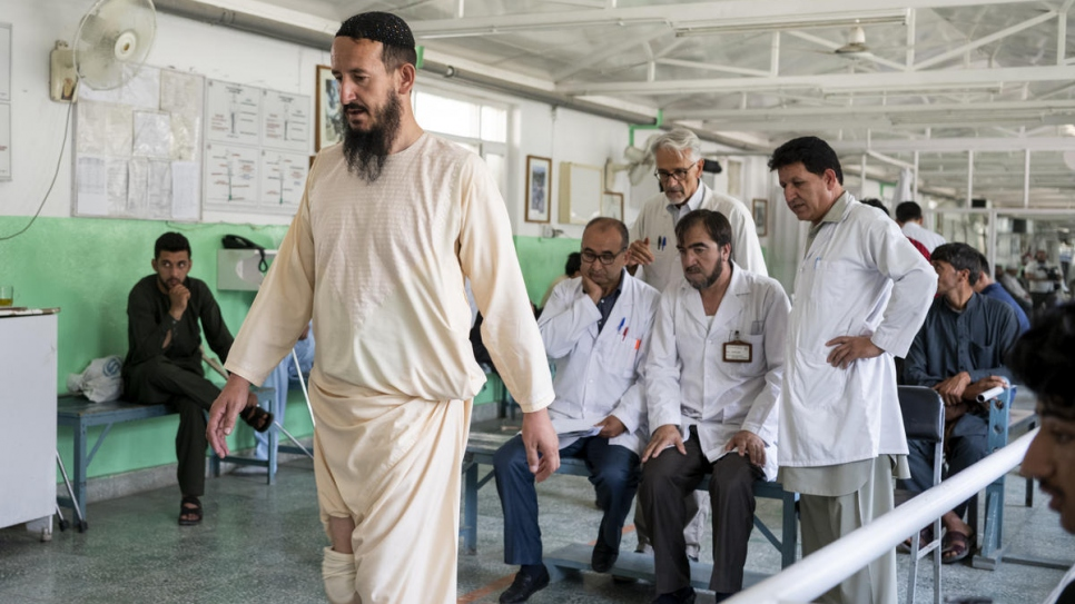 Afghan nurse Fahim receives physical therapy at the ICRC orthopaedic centre in Kabul, Afghanistan. He was 11 when a landmine explosion took one of his legs.