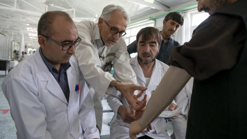Italian physiotherapist Alberto Cairo (centre) treats a patient with his team at the physical rehabilitation centre in Kabul, Afghanistan.