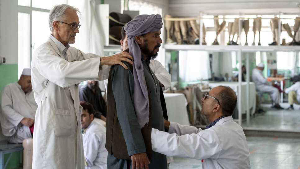 Physiotherapist Alberto Cairo (left) treats a patient at the centre in Kabul where he works.