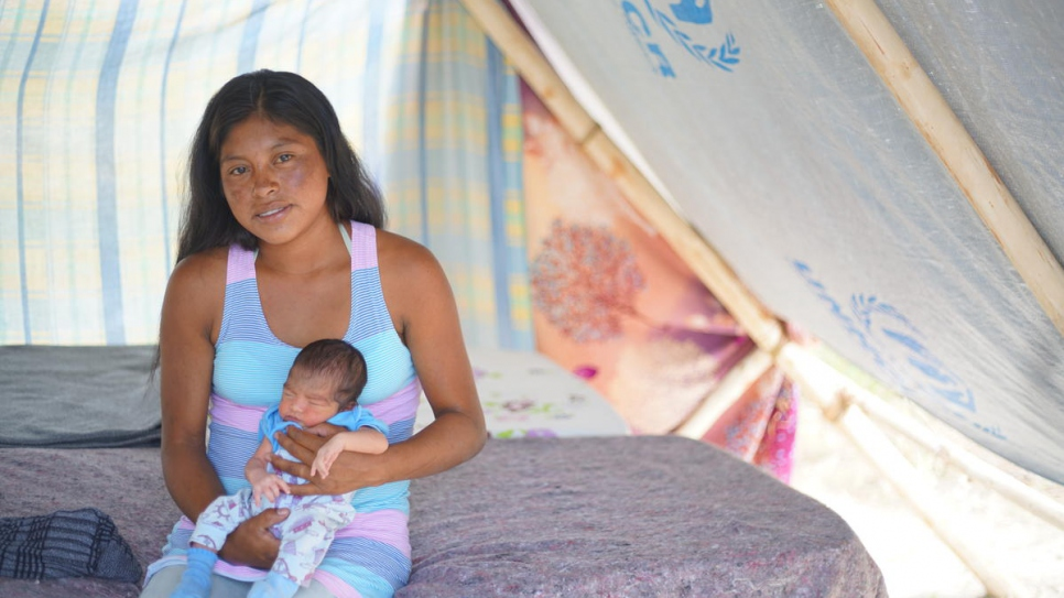Magdalena, 21, with baby Neymar who was born just days after she was forced to flee.