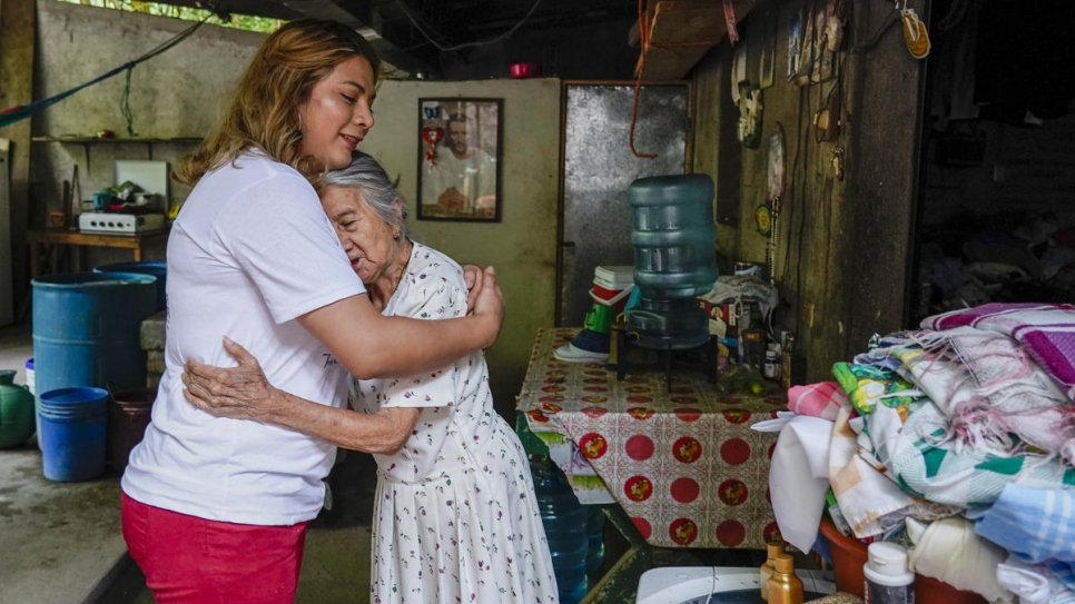 LGBT activist Bianka Rodriguez visits her grandmother, Maria Estebana, at her home in San Salvador.