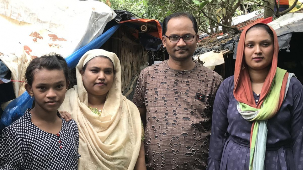 Shehana's father, Nur Alam (second right), was headmaster at a school in Maungdaw, Myanmar – one of few Rohingya appointed to senior positions – before violence drove the family to flee in 2017.