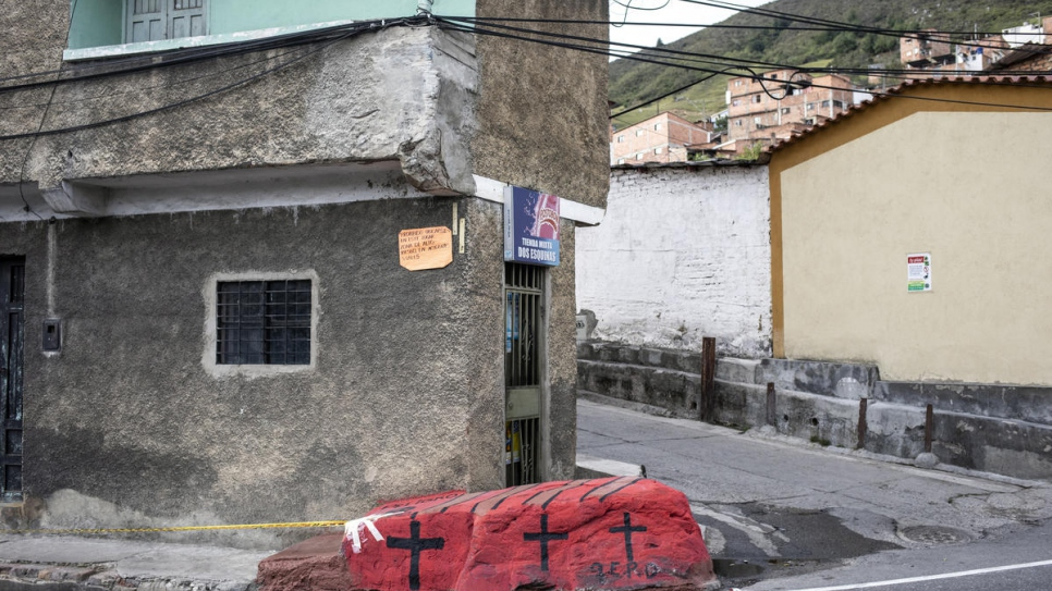 This stone was painted in red with black crosses in memory of an 18-year-old Venezuelan woman who was killed when a lorry plowed into her outside a shelter in Pamplona, Colombia.