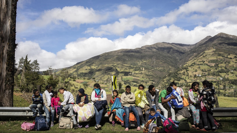 A family of 17 people has been walking for five days. They are pictured here trying to warm up in the sun after leaving their shelter early morning to set out on the road to Pamplona, Colombia.
