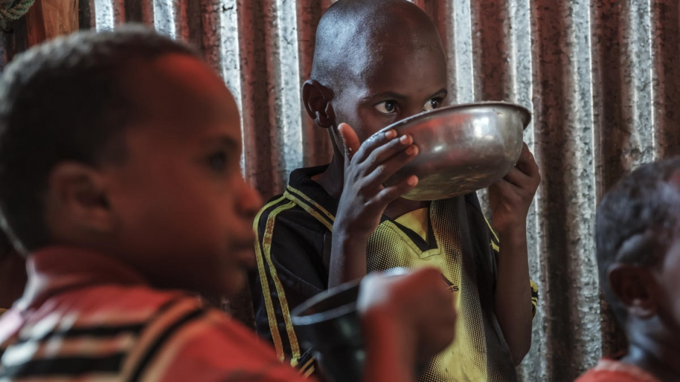 Somali refugee children eat in their shelter in a World Vision's school used as a temporary shelter in Bur Amino, Ethiopia.