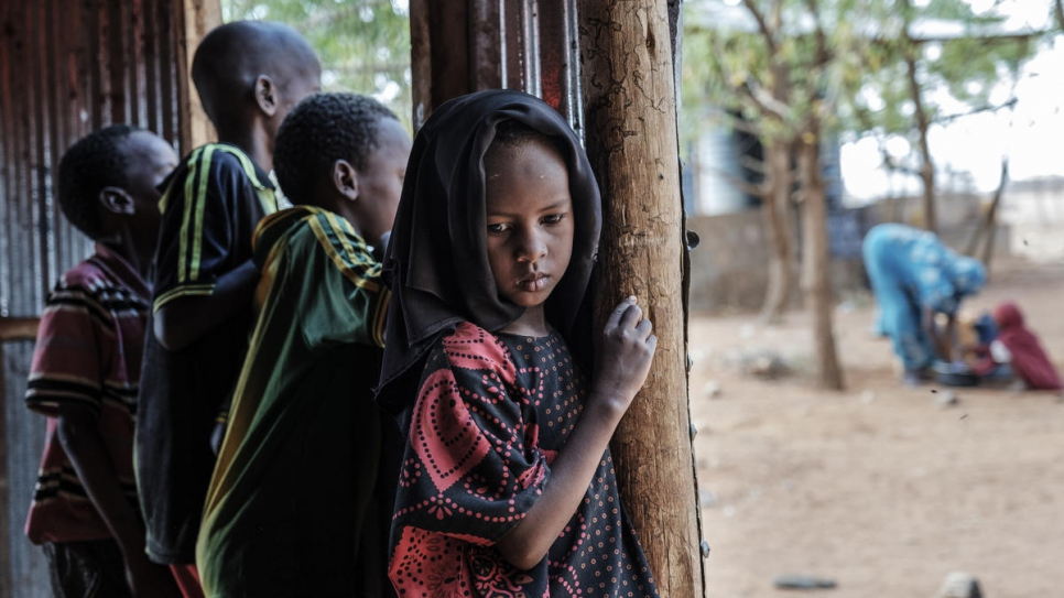 A Somali refugee girl stands next to her brothers in a World Vision's school used as a temporary shelter in Bur Amino, Ethiopia.
