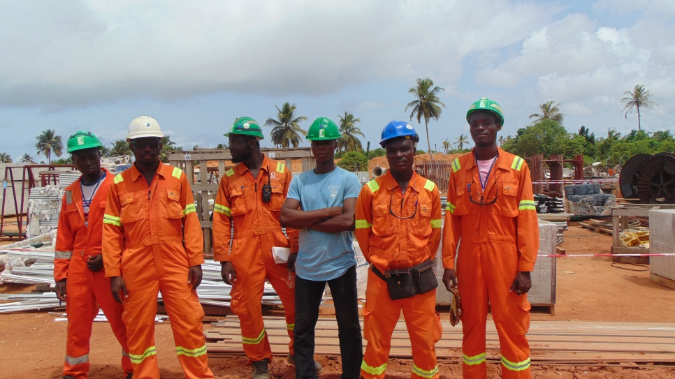 Amos and Allen (far right) stand together with their colleagues at Consar Ghana Limited's project site.