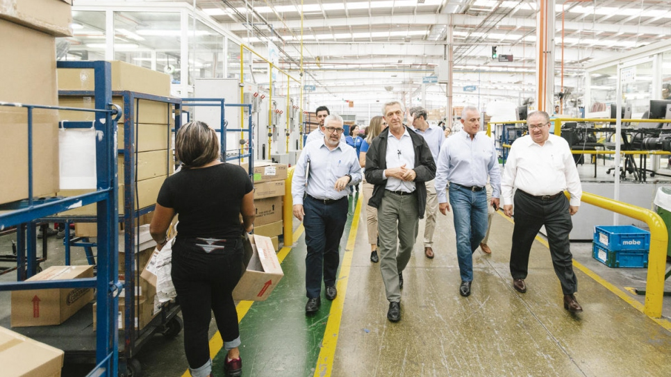 Filippo Grandi (centre) visits the Mabe production plant in Saltillo, Mexico. The plant employs resettled refugees to make appliances for distribution worldwide.