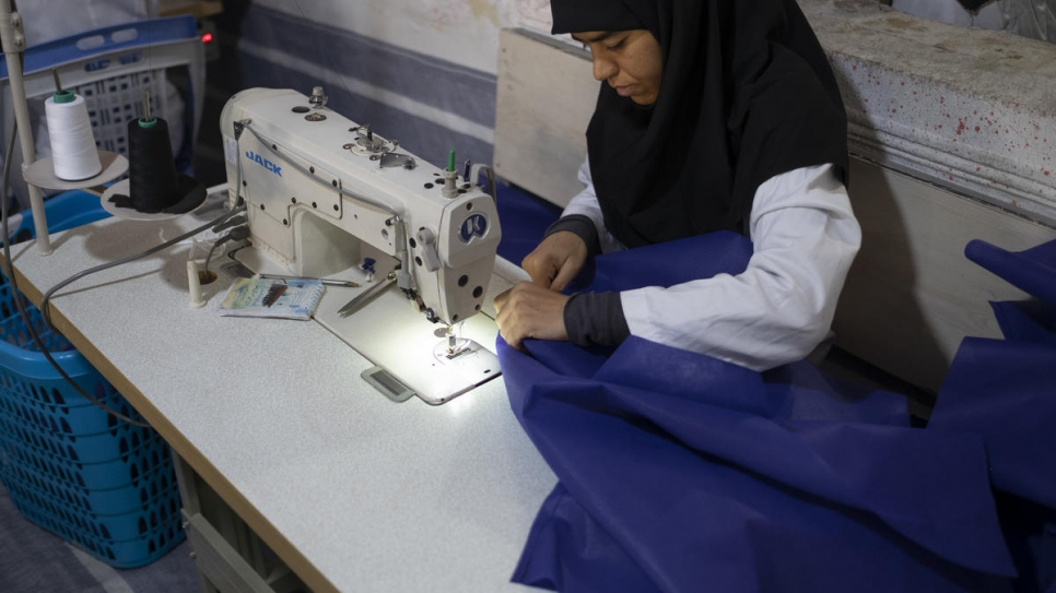 Iranian employee Fatemeh, 36, at the tailoring workshop.