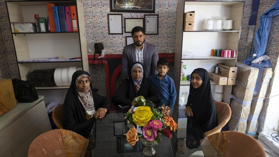 Zeynab (centre) with her husband and children at their home in Shiraz.