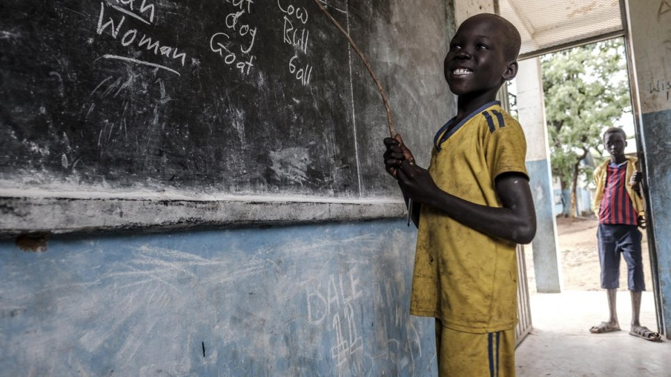 South Sudanese refugee smiles as he shows what he has learned at Jewi Refugee Camp Primary School in Gambella, Ethiopia.