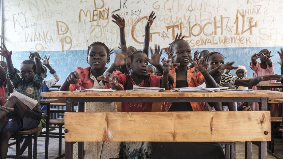"South Sudanese refugees in class at Jewi Refugee Camp Primary School in Gambella, Ethiopia. ""If they are not taught well, they will not succeed,"" says teacher Koat Reath."