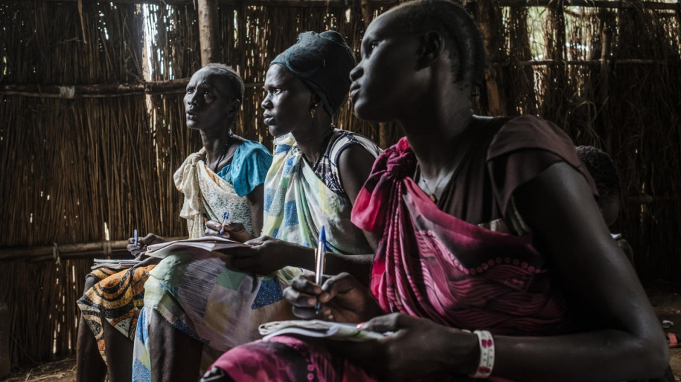 South Sudanese refugees sit in a classroom in a private tuition school for adults at Jewi Refugee Camp in Gambella, Ethiopia.