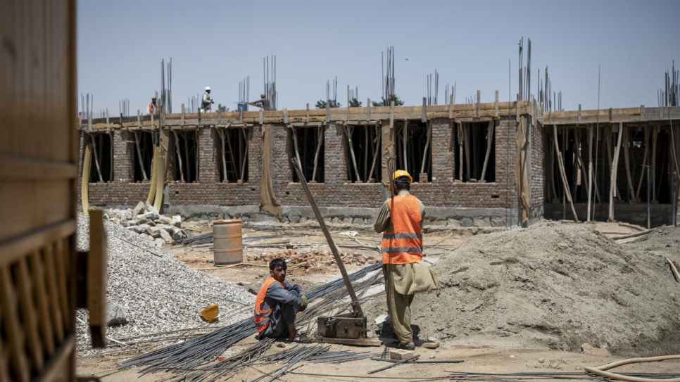 Construction workers build a primary school in Qarabagh, funded by UNHCR.