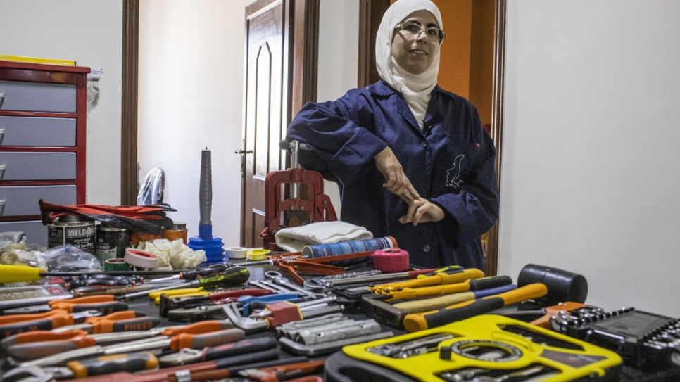 Safaa stands in her training academy in Irbid, Jordan, where she teaches plumbing.