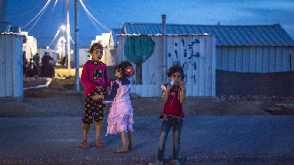 After opening of Azraq Refugee Camp's solar power plant, Syrian refugees can enjoy the evening outside their shelters.