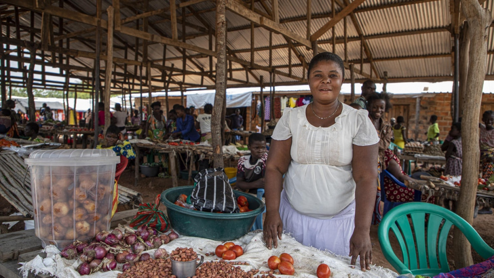 Mukea Chungu, a refugee from DRC,  stands at a  market stall in Mantapala settlement, Zambia.