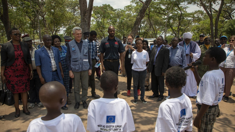 UN High Commissioner for Refugees Filippo Grandi is welcomed by young refugees from the Democratic Republic of the Congo at Mantapala settlement, Zambia.