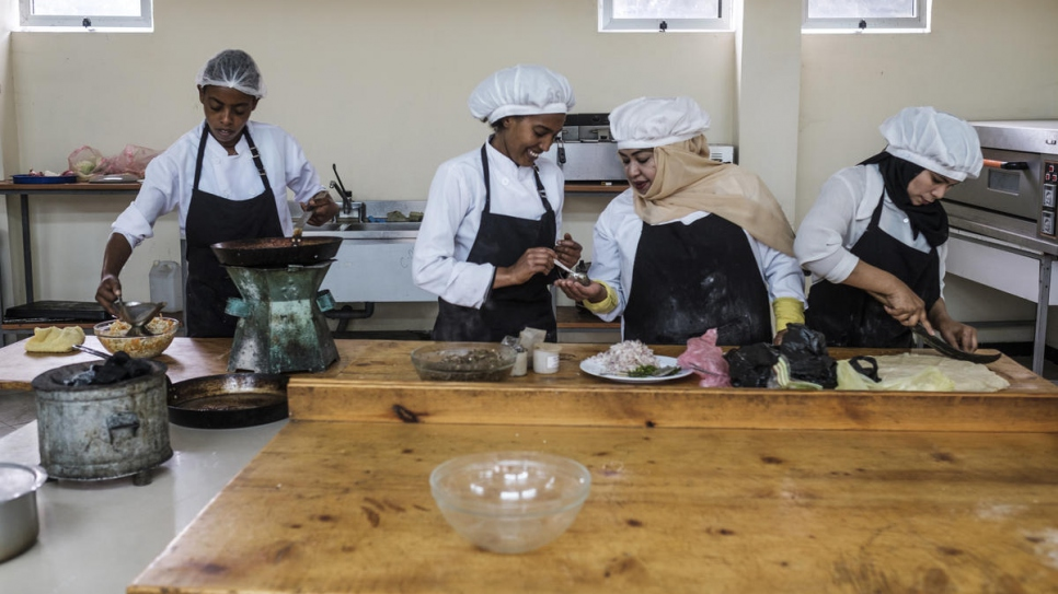 Yemeni refugee Hanan and her Ethiopian friend Yanchinew (centre) prepare food as part of a cooking course at Nefas Silk Polytechnic College in Addis Ababa, Ethiopia.