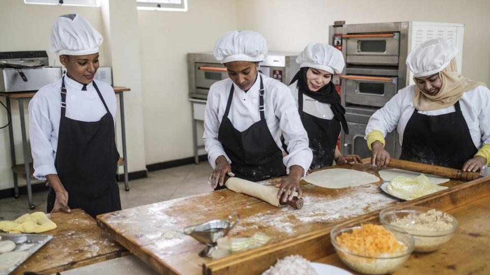 Refugees and their Ethiopian counterparts prepare food together as part of a cooking course at Nefas Silk Polytechnic College in Addis Ababa, Ethiopia.
