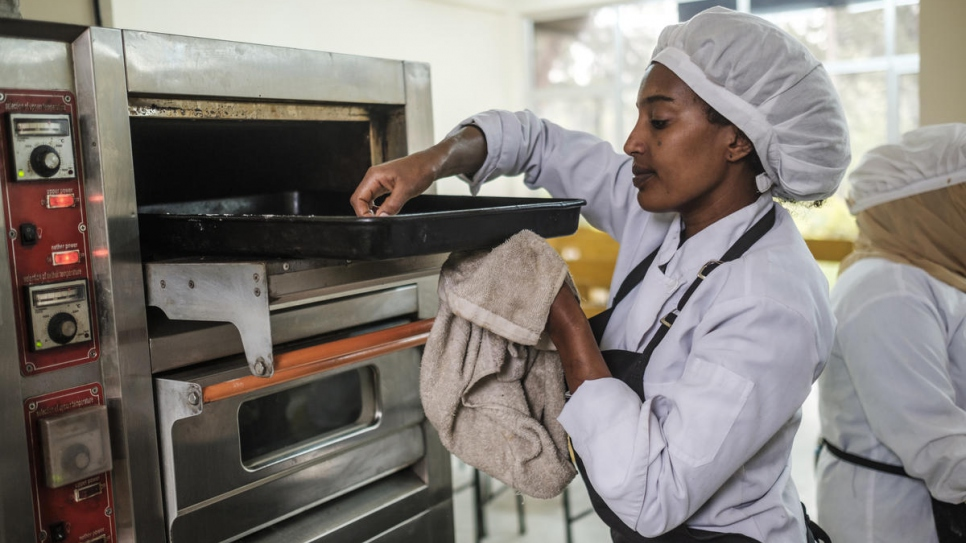 Yanchinew, an Ethiopian woman, prepares food as part of a cooking course for nationals and refugees at Nefas Silk Polytechnic College in Addis Ababa, Ethiopia.