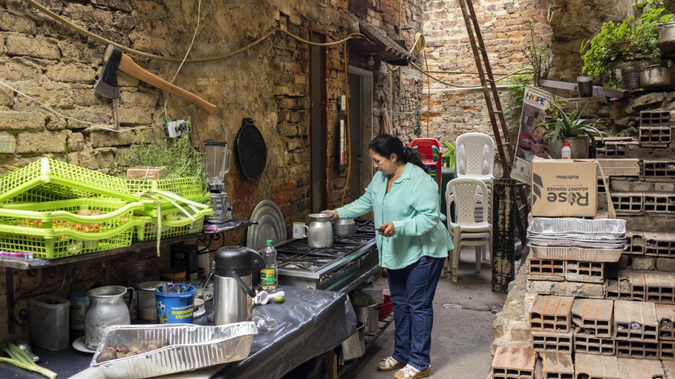 Marta Duque prepares breakfast in the yard of her home in Pamplona, Colombia.