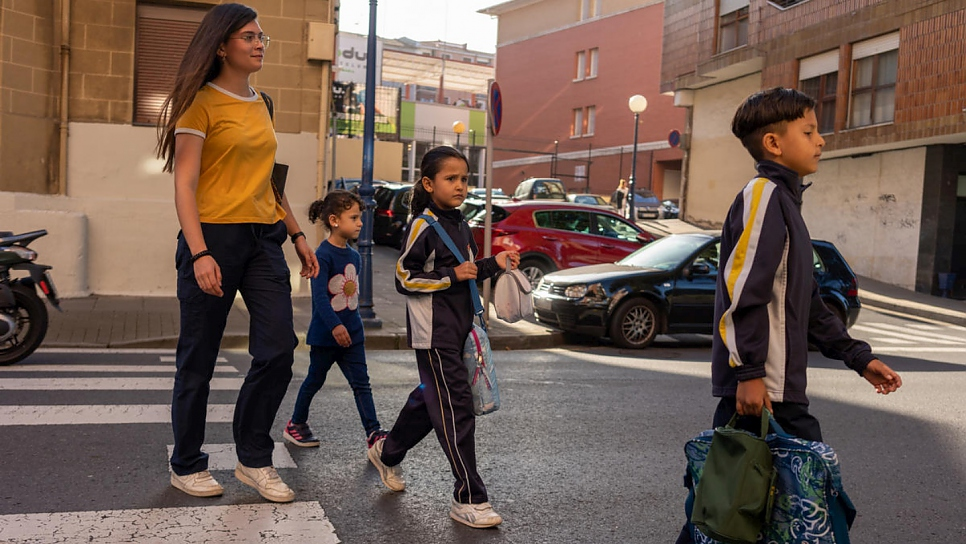 Volunteer Nagore picks up the children – from left, Meshael, 5, Sidra, 6, and Adnaan, 9 – from their school near Bilbao.