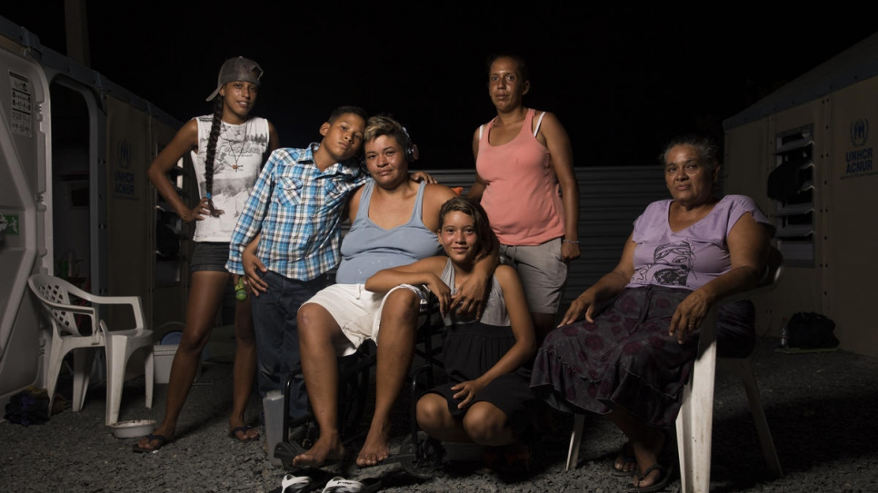 Moisés' family with his sister Valentina in Rondon 3 shelter in Boa Vista, Brazil.