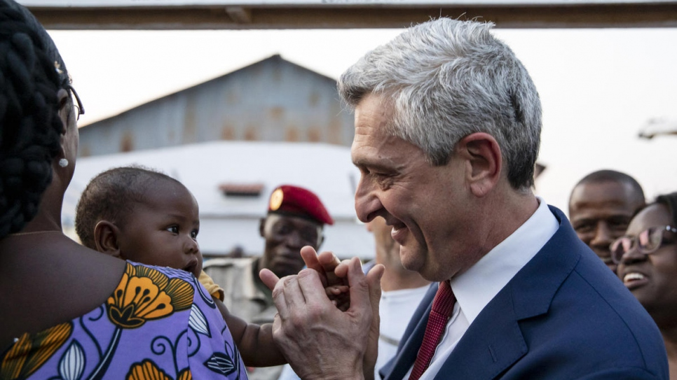 Minister for Humanitarian Action and National Reconciliation Virginie Baïkoua (left) and UN High Commission for Refugees Filippo Grandi (centre) greet refugees returning to Bangui, Central African Republic.