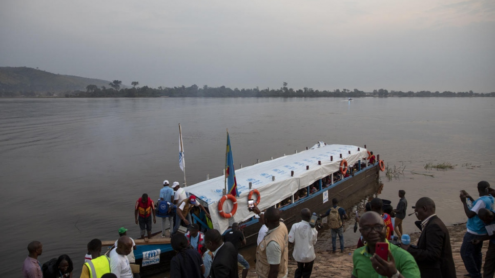 A boat carrying 200 voluntary returnees from the Democratic Republic of the Congo arrives in Bangui, the Central African Republic