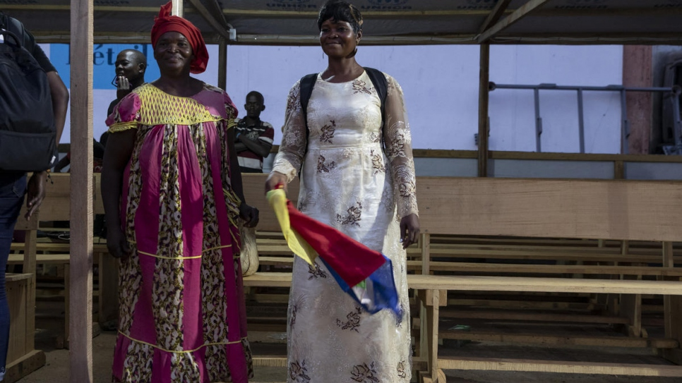 Returnee Marie Josephat Bemba (left) smiles on reaching Bangui with her daughters and grand daughter.