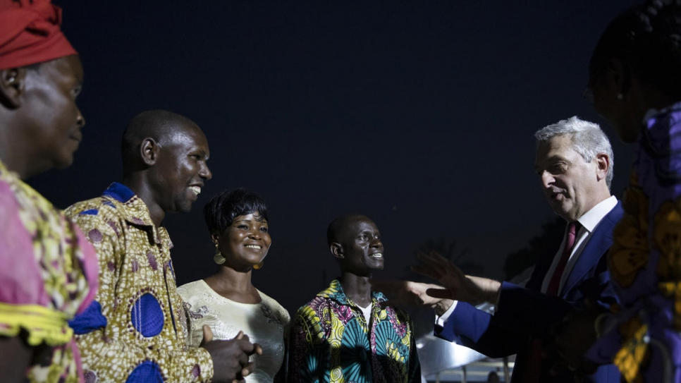 UN High Commissioner for Refugees Filippo Grandi (right) listens to returning refugees in the Central African Republic.