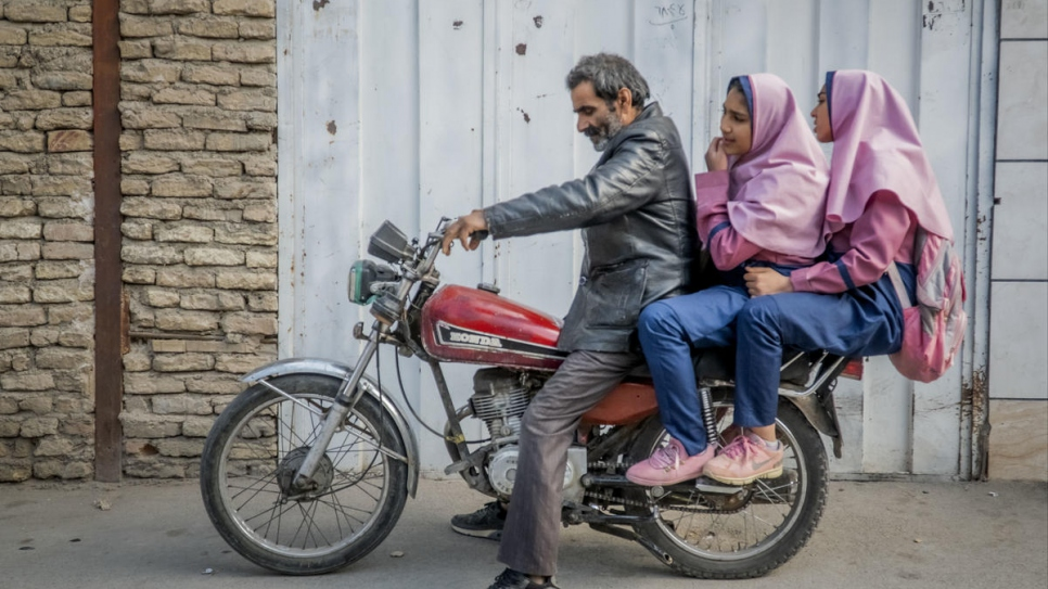 Afghan refugee Besmellah drives his daughters Parisa, 16, and Parimah, 14, to school, 10 kilometres from their home home in Esfahan, Iran.