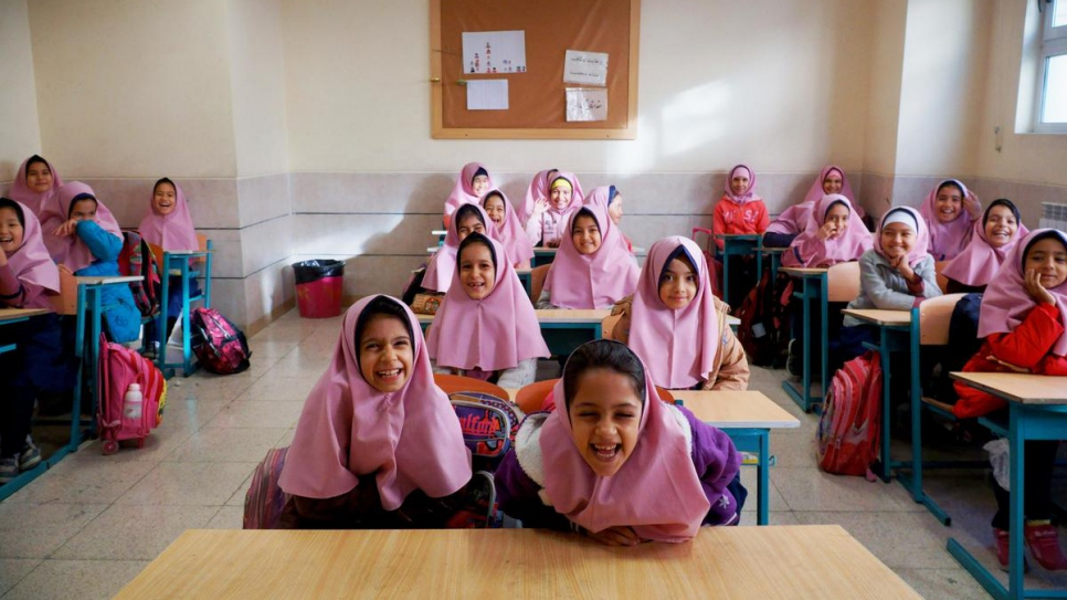 Students at Vahdat Primary School try to contain their giggles for a group photo before their teacher comes to class.